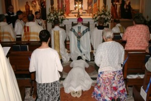 Priests in front pew kneeling for Litany of the Saints
